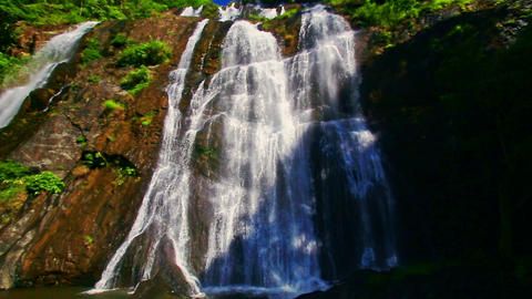 Close View of Waterfall among Forestry Rocky Hills Footage