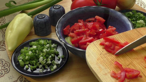 Fresh raw vegetable salad with tomatoes Footage
