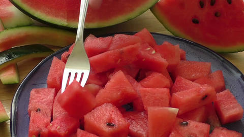 Fresh water melon pieces in blue bowl Live Action