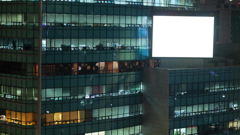 Timelapse of office building and blank advert screen at night. Seoul, South Kore Footage