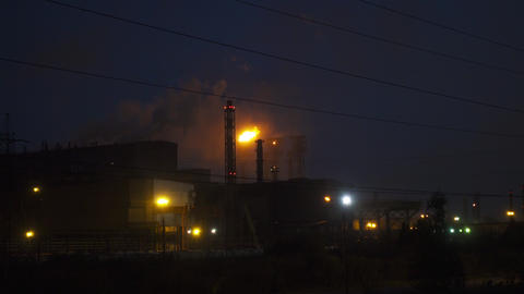 Emissions from chimneys of plant at night Footage