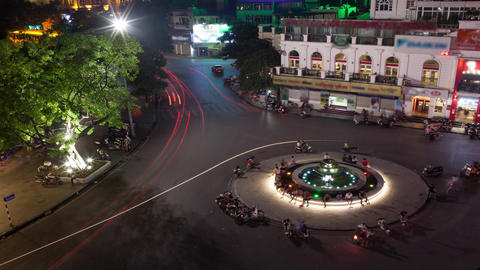 Time lapse shot of circular intersection at night, aerial view of Quang truong D