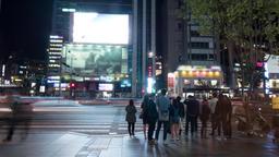 Timelapse of pedestrians on zebra crossing in night Seoul, South Korea Footage