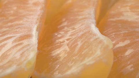Mandarin slices close-up. Super macro video. Exotic fruit Live Action