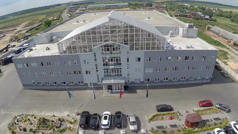 Aerial view of building outside the town and parked cars Footage