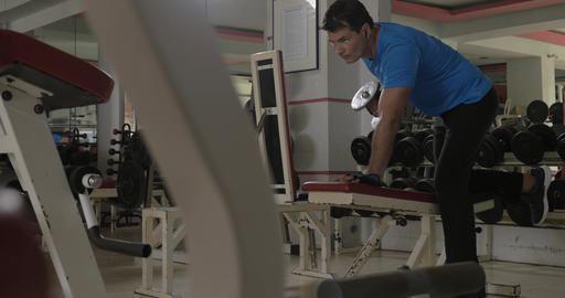 At the gym young man doing exercise for triceps Footage