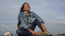 Happy Teen Girl Sitting Relaxing And Daydreaming Footage