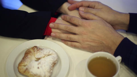 Male hands embracing a woman's hands Footage