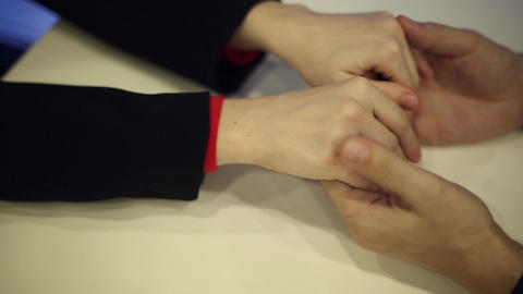 Male hands embracing a woman's hands Live Action