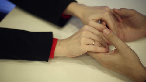 Female hands embracing a man's hands Live Action