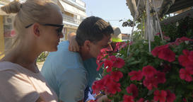 Mother father and son snuff red flowers from hanging... Stock Video Footage