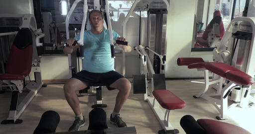 Grown man in gym performs exercises chest press Footage