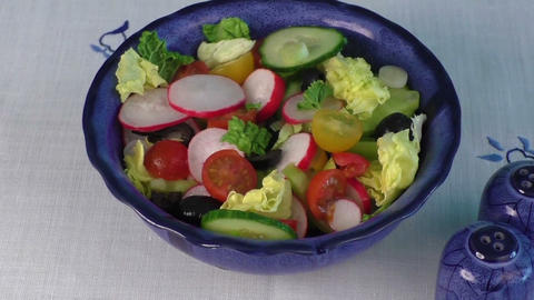 Fresh salad with vegetables in a bowl. Healthy food Live Action