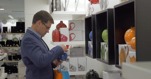 In store of Thessaloniki, Greece man choose kettle Footage
