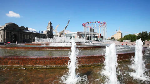 Fountain near the train Kievskiy rail station and European flags on flagpoles Footage