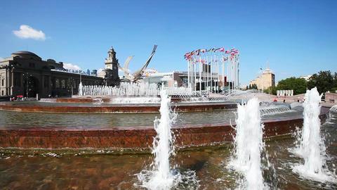 Fountain near the train Kievskiy rail station and European flags on flagpoles Footage