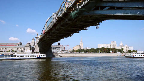 Boat sails under the bridge in Moscow city Footage