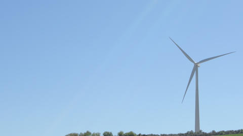 Wind turbine of renewable energy moving the blades with blue sky a sunny day Live Action