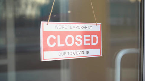 Sign we are open after covid. We Are Open Sign on the Glass Door Live Action