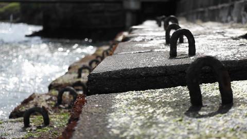 Ocean waters are kept at bay with huge stone blocks Footage