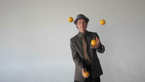 A man is juggling four balls Stock Video Footage