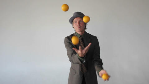 A Man Is Juggling Four Balls stock footage
