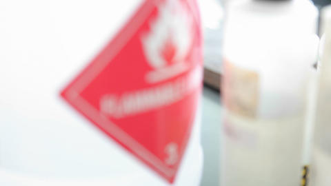 A label warns that the substance in the container may... Stock Video Footage