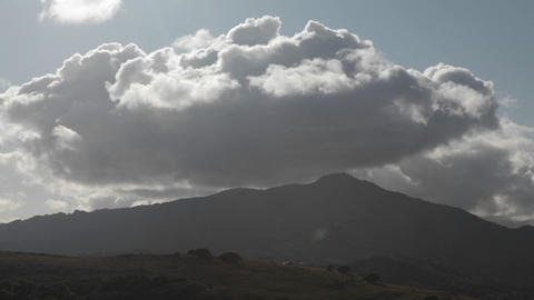 Storm clouds pass over a hilly area Stock Video Footage