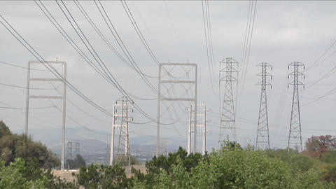 Power lines stretch from tower to tower Stock Video Footage