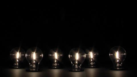 Light bulbs slowly turn on and reach full brightness Stock Video Footage