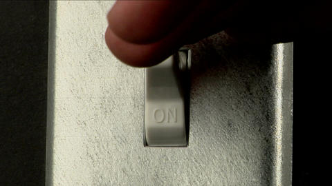 A hand turns off a light switch Stock Video Footage