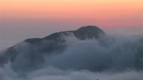 Clouds rolls across the sky above a rock formation in... Stock Video Footage