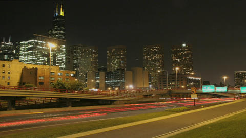 Traffic passes along a city freeway at night Stock Video Footage