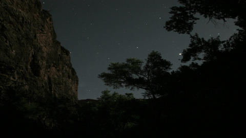 The moon casts a shadow on a cliff Stock Video Footage