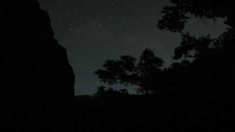 The moon casts a shadow on a cliff Footage