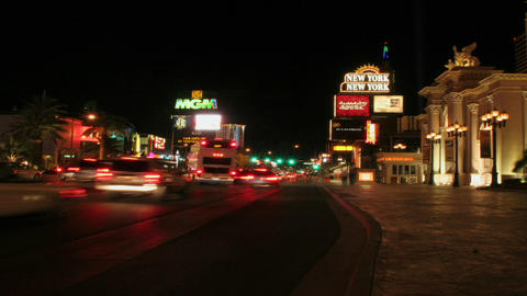 Pedestrians and traffic travel along the Las Vegas Strip... Stock Video Footage