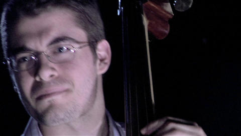 A man plays the bass fiddle Footage