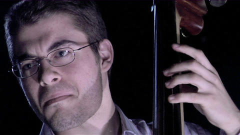 A man plays the bass fiddle Stock Video Footage