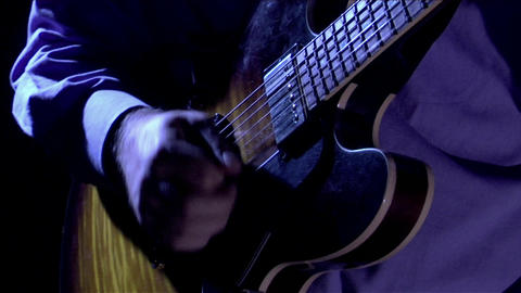 A man plays the guitar Footage