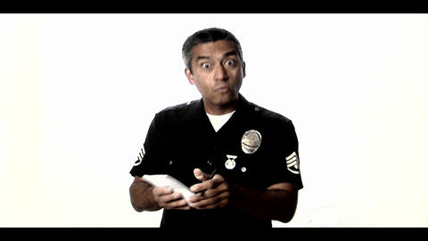 A police officer writes up and offender and speaks Stock Video Footage