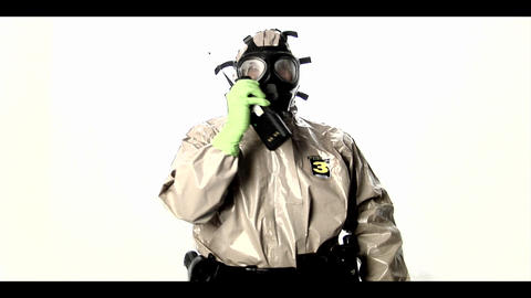 A man in a hazmat suit speaks into a walkie-talkie Stock Video Footage