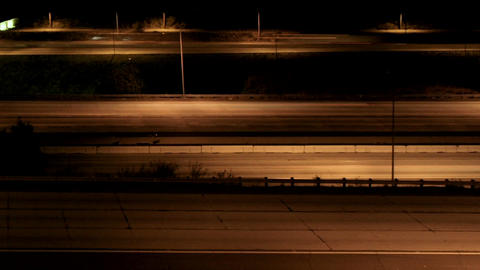 Vehicles drive on a freeway at night Stock Video Footage
