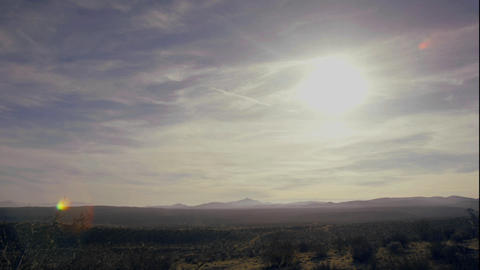 Wispy clouds float over the desert Stock Video Footage