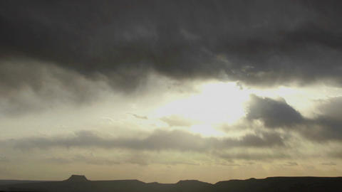 Cumulus clouds move over the desert Stock Video Footage