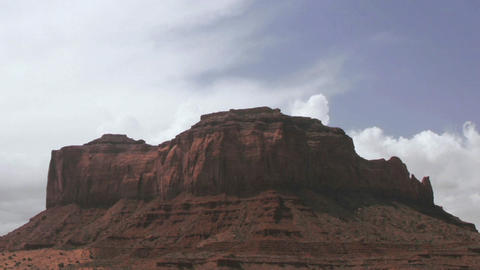 Clouds pass over a mesa in the desert Stock Video Footage