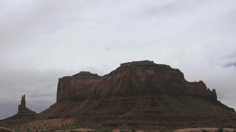 Clouds pass over a mesa in the desert Live Action