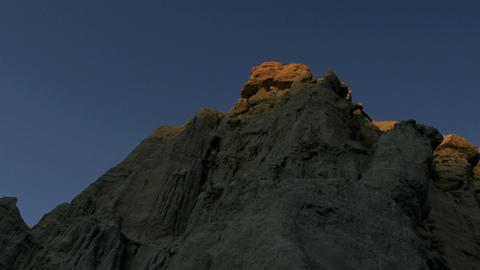 Sunlight shines over a mountain in the desert Stock Video Footage