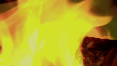 Flickering orange flames burn in a blazing fire Stock Video Footage