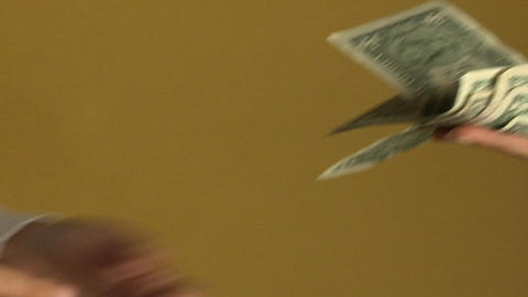 A woman pays a person with a stack of dollar bills Stock Video Footage