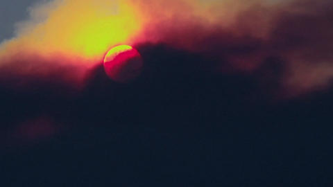 Smoke passes over the sun Stock Video Footage
